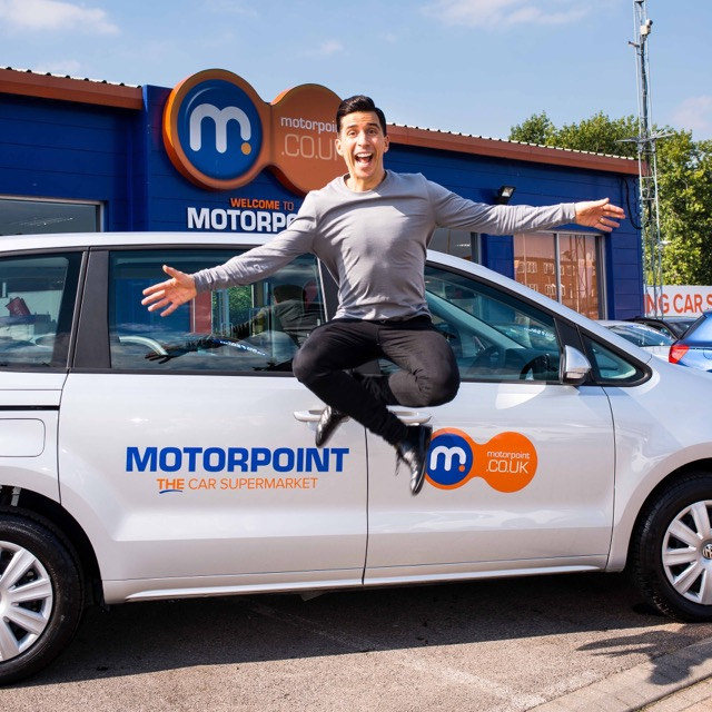 Russell Kane jumps for joy after collecting his new car from Motorpoint