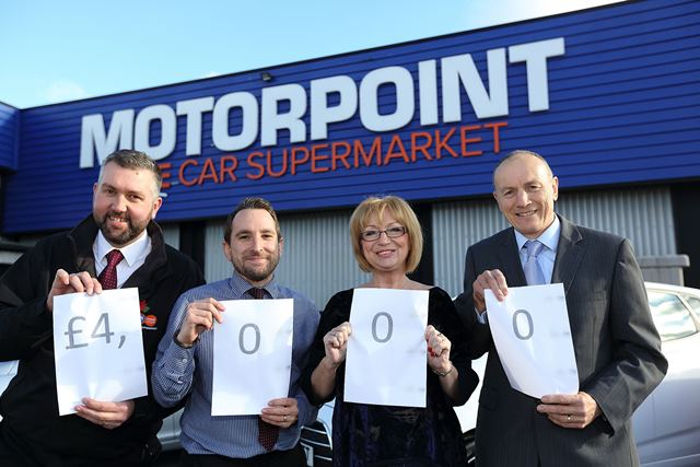 From the left, Aaron Parton, Sales Controller at Motorpoint; Kevin Wilding, Business Support Manager at Motorpoint; Gina Repton and Danny Smith, Children First Derby