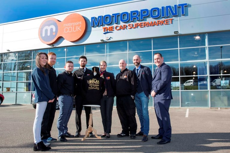 The Motorpoint Birtley team with Mark Solan, second right, Founder of the Solan Connor Fawcett Family Cancer Trust