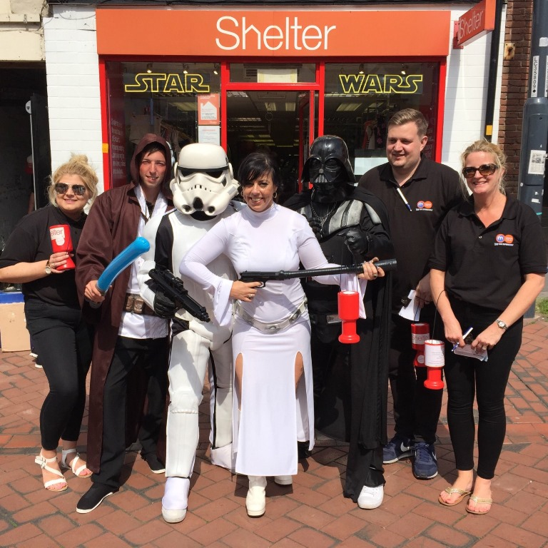 Tara Haley, Branch Manager for Shelter Derby, centre is pictured with the Motorpoint team outside the Shelter store on St Peters Lane in the city