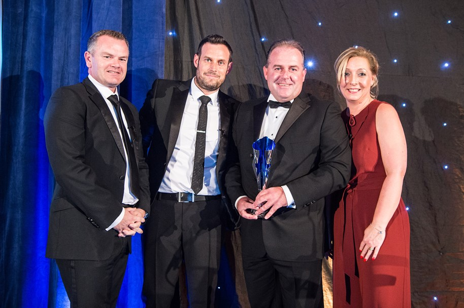 Kevin Cartwright, General Manager of Motorpoint in Widnes, celebrates winning with his award with the Motorpoint directors
