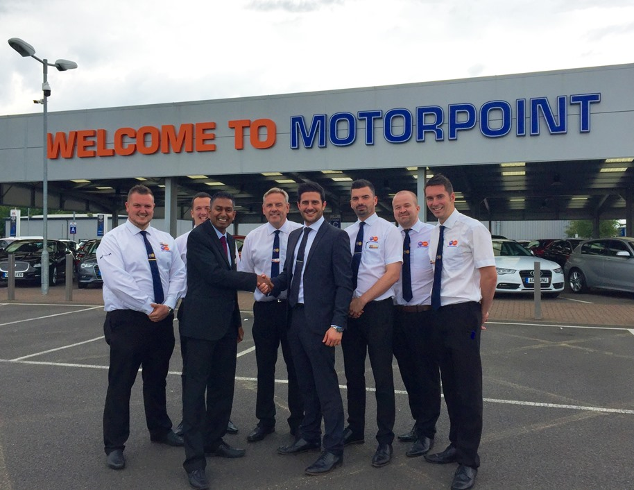 Tom Stanton is pictured with Nilesh Patel from Sue Ryder Thorpe Hall and members of the team at Motorpoint in Peterborough