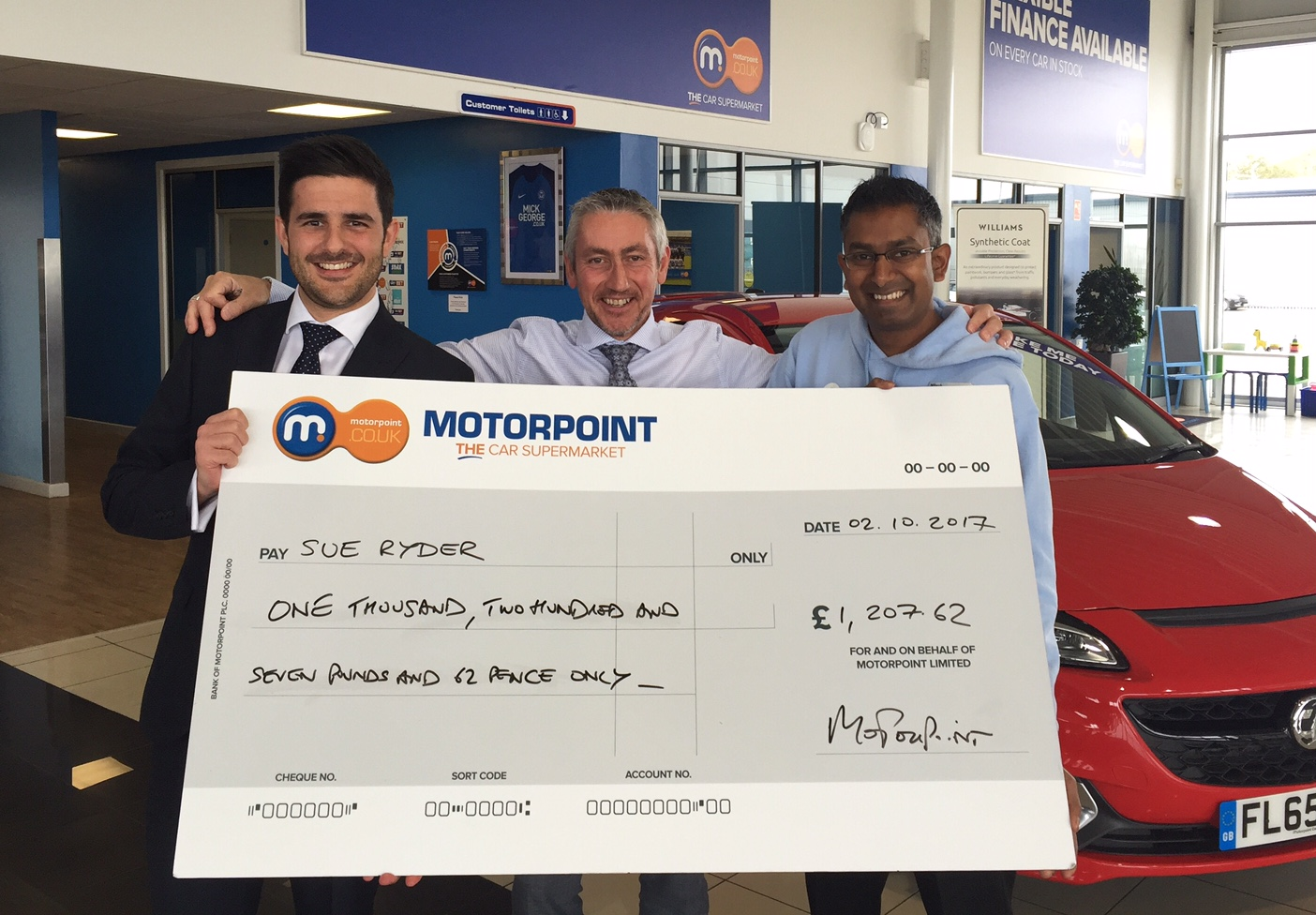 Tom Stanton, General Manager of Motorpoint in Peterboroug, hands over a cheque to Nilesh Patel from Sue Ryder Thorpe Hall in Peterborough