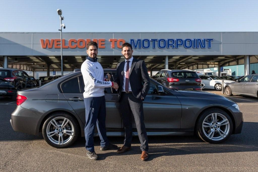 Louis Smith collects the keys for his BMW 3 Series from Motorpoint Peterborough's Tom Stanton