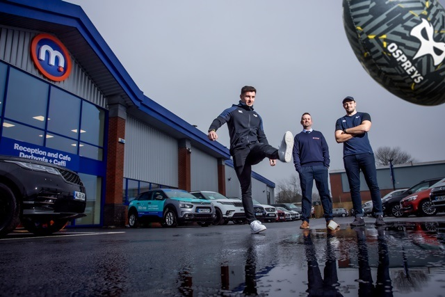 The Osprey's scrumhalf Matthew Aubrey helps kick off Motorpoint's arrival in Swansea together with Andrew Davies, General Sales Manager at Motorpoint and Cory Allen